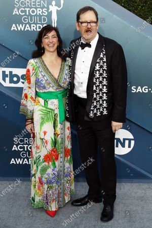 Stock Image of Julie Millett (L) and John Pirruccello arrive for the 26th annual Screen Actors Guild Awards ceremony at the Shrine Auditorium in Los Angeles, California, USA, 19 January 2020.