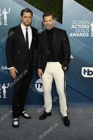 Nikolaj Coster-Waldau (R) and guest  arrives for the 26th annual Screen Actors Guild Awards ceremony at the Shrine Auditorium in Los Angeles, California, USA, 19 January 2020.