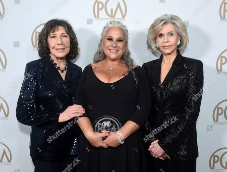 Lily Tomlin, Marta Kauffman, Jane Fonda. Lily Tomlin, from left, Marta Kauffman, winner of the Norman Lear Achievement Award, and Jane Fonda attend the 31st Annual Producers Guild Awards at the Hollywood Palladium, in Los Angeles