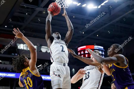 Keith Williams, Tyrie Jackson. Cincinnati's Keith Williams (2) shoots over East Carolina's Tyrie Jackson (10) during the first half of an NCAA college basketball game, in Cincinnati
