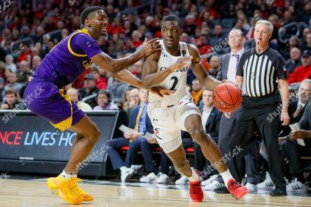 Keith Williams, J.J. Miles. Cincinnati's Keith Williams (2) drives against East Carolina's J.J. Miles, left, during the first half of an NCAA college basketball game, in Cincinnati