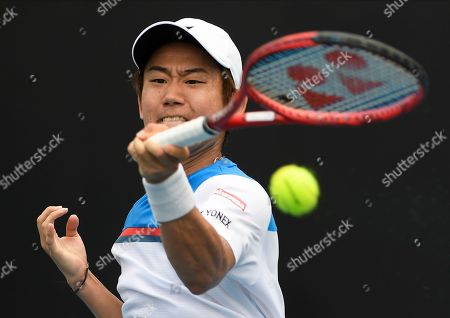 Japan's Yoshihito Nishioka makes a forehand return to Serbia's Laslo Djere during their first round singles match the Australian Open tennis championship in Melbourne, Australia