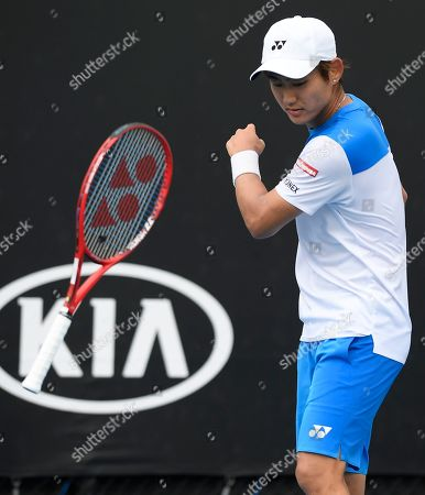 Japan's Yoshihito Nishioka throws his racket in frustration during his first round match against Serbia's Laslo Djere at the Australian Open tennis championship in Melbourne, Australia
