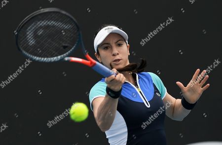 United States' Christina McHale hits a forehand return to Croatia's Petra Martic during their first round singles match the Australian Open tennis championship in Melbourne, Australia