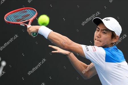 Japan's Yoshihito Nishioka makes a backhand return to Serbia's Laslo Djere during their first round singles match at the Australian Open tennis championship in Melbourne, Australia