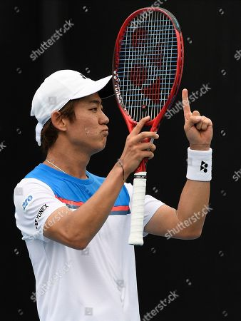Japan's Yoshihito Nishioka reacts after defeating Serbia's Laslo Djere during their first round singles match the Australian Open tennis championship in Melbourne, Australia