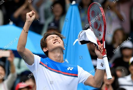 Japan's Yoshihito Nishioka reacts after defeating Serbia's Laslo Djere during their first round singles match at the Australian Open tennis championship in Melbourne, Australia