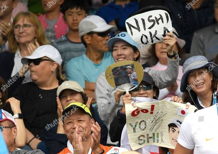 Supporters of Japan's Yoshihito Nishioka react after his win over Serbia's Laslo Djere in their first round singles match at the Australian Open tennis championship in Melbourne, Australia