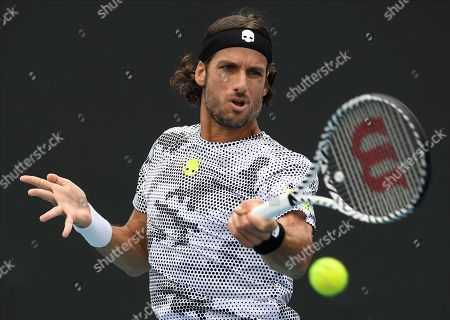 Spain's Feliciano Lopez makes a forehand return to compatriot Roberto Bautista Agut during their first round singles match at the Australian Open tennis championship in Melbourne, Australia