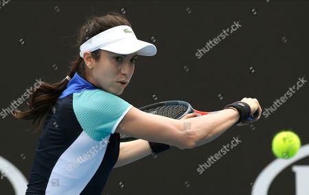 United States' Christina McHale makes a backhand return to Croatia's Petra Martic during their first round singles match the Australian Open tennis championship in Melbourne, Australia