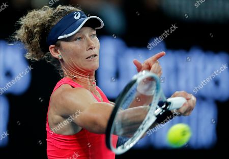 Australia's Samantha Stosur makes a forehand return to Catherine McNally of the United States during their first round singles match at the Australian Open tennis championship in Melbourne, Australia