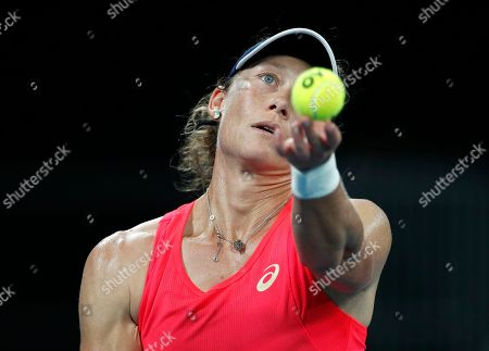Australia's Samantha Stosur serves to Catherine McNally of the United States during their first round singles match the Australian Open tennis championship in Melbourne, Australia