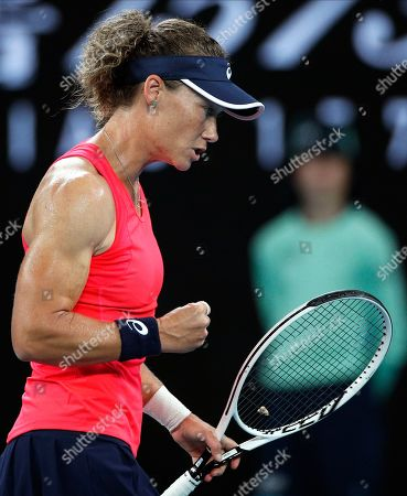 Australia's Samantha Stosur reacts after winning a point against Catherine McNally of the United States during their first round singles match at the Australian Open tennis championship in Melbourne, Australia