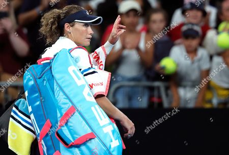 Australia's Samantha Stosur waves as she leaves the court following her first round loss to Catherine McNally of the United States at the Australian Open tennis championship in Melbourne, Australia