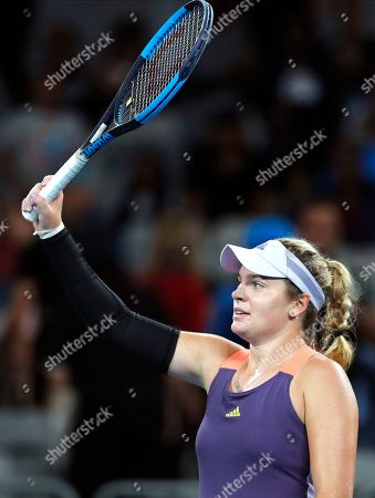 Stock Picture of Catherine McNally of the United States reacts after defeating Australia's Samantha Stosur in their first round singles match at the Australian Open tennis championship in Melbourne, Australia