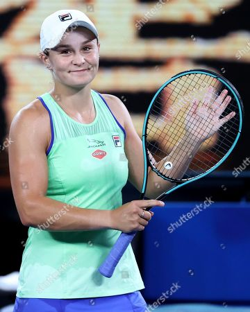 Australia's Ashleigh Barty waves after defeating Lesia Tsurenko of Ukraine in their first round singles match at the Australian Open tennis championship in Melbourne, Australia