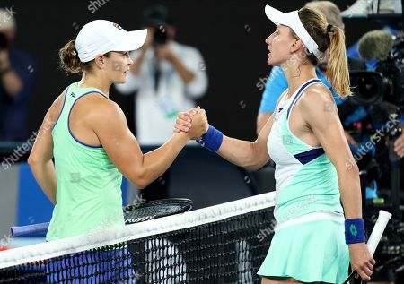 Australia's Ashleigh Barty, left, is congratulated by Lesia Tsurenko of Ukraine after winning their first round singles match at the Australian Open tennis championship in Melbourne, Australia