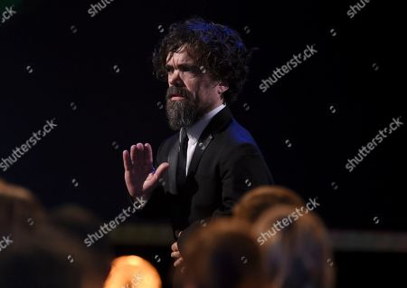 """Peter Dinklage is seen in the audience before accepting the award for outstanding performance by a male actor in a drama series for """"Game of Thrones"""" at the 26th annual Screen Actors Guild Awards at the Shrine Auditorium & Expo Hall, in Los Angeles"""