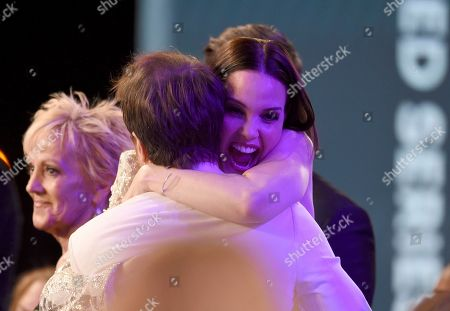 """Sam Rockwell, Leslie Bibb. Sam Rockwell, foreground, is congratulated by his wife Leslie Bibb before going on stage to accept accepts the award for outstanding performance by a male actor in a television movie or miniseries for """"Fosse/Verdon"""" at the 26th annual Screen Actors Guild Awards at the Shrine Auditorium & Expo Hall, in Los Angeles"""