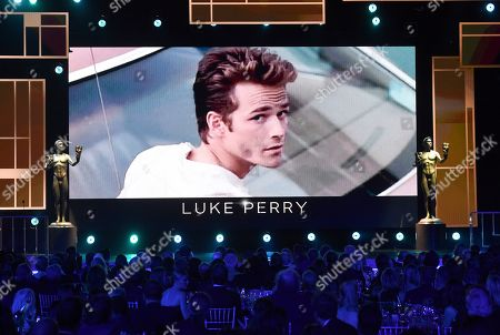 Peter Fonda. Luke Perry appears on screen during the In Memoriam presentation at the 26th annual Screen Actors Guild Awards at the Shrine Auditorium & Expo Hall, in Los Angeles