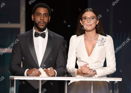 Stock Image of Jharrel Jerome, Millie Bobby Brown. Jharrel Jerome, left, and Millie Bobby Brown present the award for outstanding performance by a female actor in a comedy series at the 26th annual Screen Actors Guild Awards at the Shrine Auditorium & Expo Hall, in Los Angeles