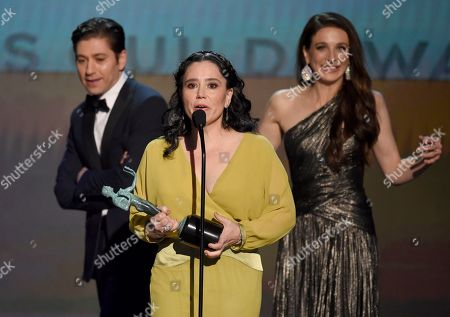 """Stock Image of Alex Borstein,Jason Bateman, Marin Hinkle. Alex Borstein accepts the the award for outstanding performance by an ensemble in a comedy series for """"The Marvelous Mrs. Maisel"""" at the 26th annual Screen Actors Guild Awards at the Shrine Auditorium & Expo Hall, in Los Angeles. Looking on in background are Michael Zegen and Marin Hinkle"""
