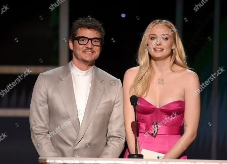 Stock Photo of Pedro Pascal, Sophie Turner. Pedro Pascal, left, and Sophie Turner present the award for outstanding performance by a female actor in a television movie or miniseries at the 26th annual Screen Actors Guild Awards at the Shrine Auditorium & Expo Hall, in Los Angeles