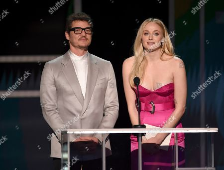 Stock Picture of Pedro Pascal, Sophie Turner. Pedro Pascal, left, and Sophie Turner present the award for outstanding performance by a female actor in a television movie or miniseries at the 26th annual Screen Actors Guild Awards at the Shrine Auditorium & Expo Hall, in Los Angeles