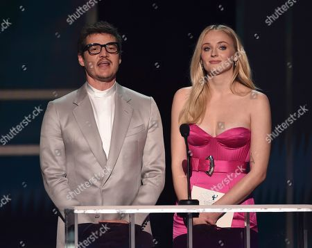 Pedro Pascal, Sophie Turner. Pedro Pascal, left, and Sophie Turner present the award for outstanding performance by a female actor in a television movie or miniseries at the 26th annual Screen Actors Guild Awards at the Shrine Auditorium & Expo Hall, in Los Angeles