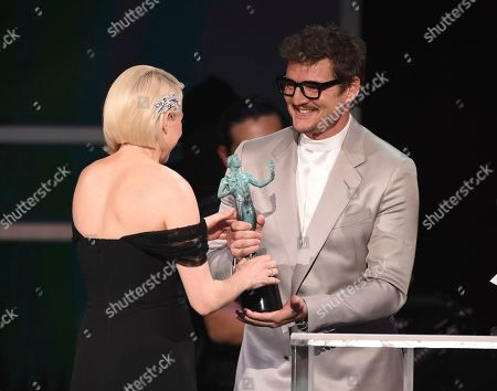 """Pedro Pascal, Michelle Williams. Pedro Pascal, right, presents the award to Michelle Williams for outstanding performance by a female actor in a television movie or miniseries for """"Fosse/Verdon"""" at the 26th annual Screen Actors Guild Awards at the Shrine Auditorium & Expo Hall, in Los Angeles"""