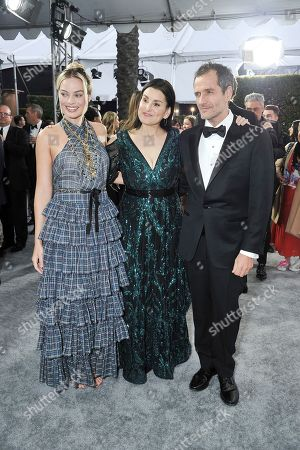 Margot Robbie, Shannon McIntosh, David Heyman. Margot Robbie, from left, Shannon McIntosh and David Heyman arrive at the 26th annual Screen Actors Guild Awards at the Shrine Auditorium & Expo Hall, in Los Angeles