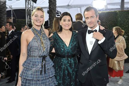 Stock Image of Margot Robbie, Shannon McIntosh, David Heyman. Margot Robbie, from left, Shannon McIntosh and David Heyman arrive at the 26th annual Screen Actors Guild Awards at the Shrine Auditorium & Expo Hall, in Los Angeles