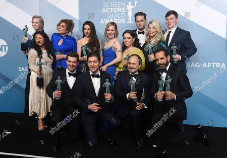 "Stock Picture of Caroline Aaron, Jane Lynch, Stephanie Hsu, Marin Hinkle, Rachel Brosnahan, Alex Borstein, Matilda Szydagis, Michael Zegen, Kevin Pollak, Tony Shalhoub, Joel Johnstone, Sean Tarantina. Jane Lynch, top from left, Caroline Aaron, Marin Hinkle, Rachel Brosnahan, Alex Borstein, Luke Kirby, Matilda Szydagis, Sean Tarantina, Stephanie Hsu, Joel Johnstone, Michael Zegen, Kevin Pollak and Tony Shalhoub pose in the press room with the award for outstanding performance by an ensemble in a comedy series for ""The Marvelous Mrs. Maisel"" at the 26th annual Screen Actors Guild Awards at the Shrine Auditorium & Expo Hall, in Los Angeles"