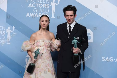 """Josh O'Connor, Erin Doherty. Erin Doherty, left, and Josh O'Connor pose in the press room with their awards for outstanding performance by an ensemble in a drama series for """"The Crown"""" at the 26th annual Screen Actors Guild Awards at the Shrine Auditorium & Expo Hall, in Los Angeles"""