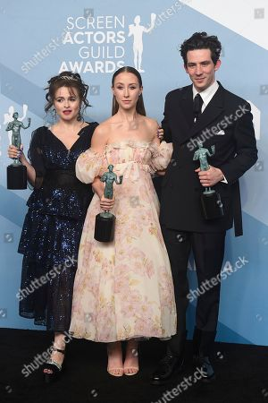 """Helena Bonham Carter, Erin Doherty, Josh O'Connor. Helena Bonham Carter, from left, Erin Doherty, and Josh O'Connor pose in the press room with the award for outstanding performance by an ensemble in a drama series for """"The Crown"""" at the 26th annual Screen Actors Guild Awards at the Shrine Auditorium & Expo Hall, in Los Angeles"""