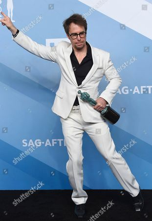"""Sam Rockwell poses with the award for outstanding performance by a male actor in a television movie or miniseries for """"Fosse/Verdon"""" in the press room at the 26th annual Screen Actors Guild Awards at the Shrine Auditorium & Expo Hall, in Los Angeles"""