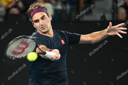 3rd seed ROGER FEDERER (SUI) in action against STEVE JOHNSON (USA) on Rod Laver Arena in a Men's Singles 1st round match on day 1 of the Australian Open in Melbourne, Australia. Federer won 63 62 62
