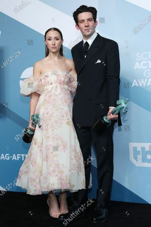 Erin Doherty and Josh O'Connor pose with the SAG Award for Outstanding Performance by an Ensemble in a drama series for 'The Crown' during the 26th annual Screen Actors Guild Awards ceremony at the Shrine Auditorium in Los Angeles, California, USA, 19 January 2020.