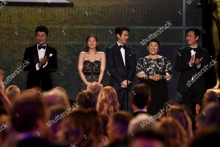 "Kang-Ho Song, Cho Yeo-jeong, Choi Woo-shik, Lee Jeong-eun, Lee Sun-kyun. Kang-Ho Song, from left, Cho Yeo-jeong, Choi Woo-shik, Lee Jeong-eun, and Lee Sun-kyun introduce a clip from ""Parasite at the 26th annual Screen Actors Guild Awards at the Shrine Auditorium & Expo Hall, in Los Angeles"