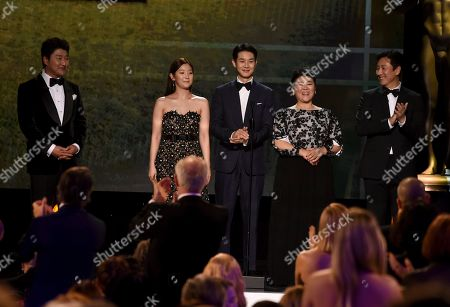 "Kang-Ho Song, Cho Yeo-jeong, Choi Woo-shik, Lee Jeong-eun, Lee Sun-kyun. Kang-Ho Song, from left, Cho Yeo-jeong, Choi Woo-shik, Lee Jeong-eun, and Lee Sun-kyun introduce a clip from ""Parasite at the 26th annual Screen Actors Guild Awards at the Shrine Auditorium & Expo Hall, in Los Angeles"