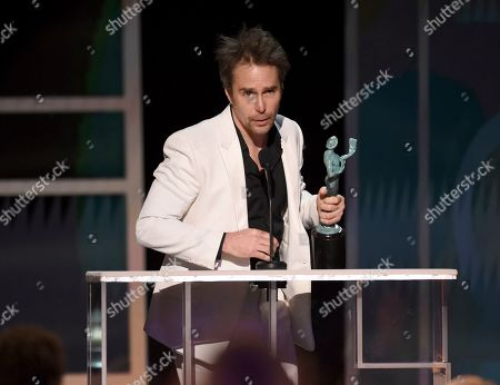 """Sam Rockwell accepts the award for outstanding performance by a male actor in a television movie or miniseries for """"Fosse/Verdon"""" at the 26th annual Screen Actors Guild Awards at the Shrine Auditorium & Expo Hall, in Los Angeles"""
