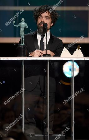 """Stock Photo of Peter Dinklage accepts the award for outstanding performance by a male actor in a drama series for """"Game of Thrones"""" at the 26th annual Screen Actors Guild Awards at the Shrine Auditorium & Expo Hall, in Los Angeles"""
