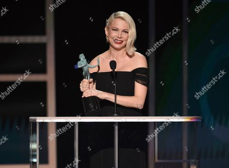 """Michelle Williams accepts the award for outstanding performance by a female actor in a television movie or miniseries for """"Fosse/Verdon"""" at the 26th annual Screen Actors Guild Awards at the Shrine Auditorium & Expo Hall, in Los Angeles"""