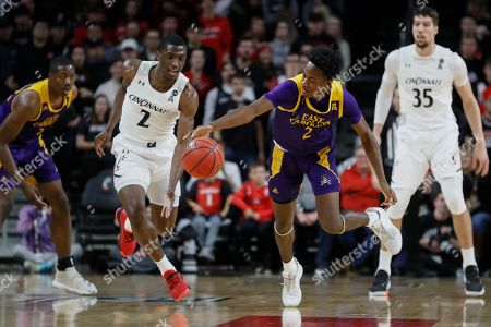 Tristen Newton, Keith Williams. East Carolina's Tristen Newton, right, and Cincinnati's Keith Williams, left, chase a loose ball during the first half of an NCAA college basketball game, in Cincinnati