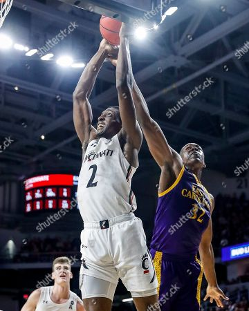Keith Williams, Charles Coleman. Cincinnati's Keith Williams (2) shoots against East Carolina's Charles Coleman (32) during the first half of an NCAA college basketball game, in Cincinnati