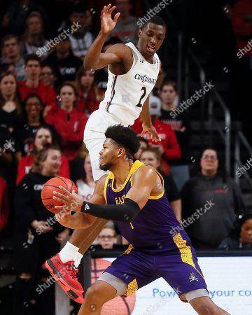 Jayden Gardner, Keith Williams. East Carolina's Jayden Gardner, below, looks to pass against Cincinnati's Keith Williams (2) during the first half of an NCAA college basketball game, in Cincinnati