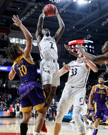 Keith Williams, Tyrie Jackson. Cincinnati's Keith Williams (2) shoots against East Carolina's Tyrie Jackson (10) during the first half of an NCAA college basketball game, in Cincinnati