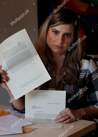 """Ana Lucia Salazar holds the letters that Legion of Christ's new director general Rev. Eduardo Robles Gil, and her abuser sent to her asking for forgiveness, during an interview in Mexico City. Salazar says she was deeply offended by the way the letters diminished the crimes and cover-up. """"It was revictimizing to me, humiliating, disgusting."""" She said"""