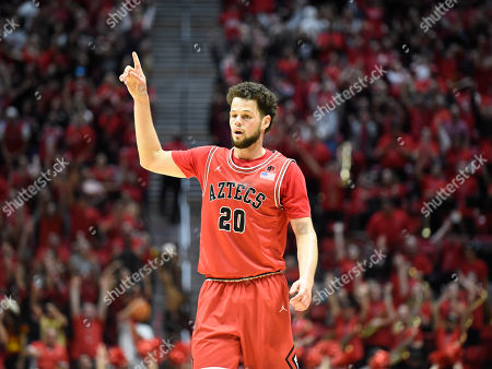 San Diego State guard Jordan Schakel (20) celebrates during the second half of an NCAA college basketball game against Nevada, in San Diego. San Diego State won 68-55