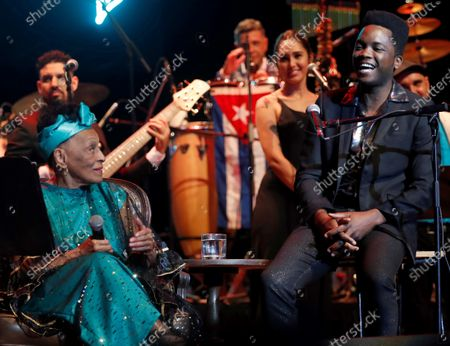 Omara Portuondo and singer and composer Erik Iglesias (R), aka Cimafunk, perform during a tribute concert to Portuondo organized by composer Roberto Fonseca (unseen) during a tribute concert organized by composer Roberto Fonseca (C-L) during the closing ceremony of 35th Havana Jazz Festival, in Havanna, Cuba, late 19 January 2020.